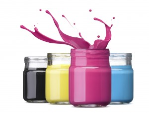 bottles of ink in cmyk colors, magenta with splash